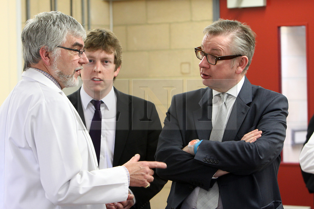 ©Licensed to London News Pictures. 04/04/2014<br /> Brooke Weston Academy, Corby, Northamptonshire. Secretary of State for Education Michael Gove MP visiting Brooke Weston Academy in Corby as part of a fact finding tour of free schools. Pictured, Michael Gove MP in Year 12 chemistry lesson with Head of Science Paul Knight and Tom Pursglove, Conservative Parliamentary Candidate for Corby and East Northants.<br /> Photo credit: Steven Prouse/ LNP