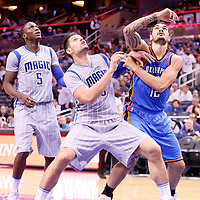 30 October 2015: Orlando Magic center Nikola Vucevic (9) vies for the rebound with Orlando Magic forward Tobias Harris (12) during the Oklahoma City Thunder 139-136 double overtime victory over the Orlando Magic, at the Amway Center, in Orlando, Florida, USA.