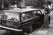 Peter McGowan with his Volvo Estate Car, London, UK, 1986.