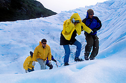 Patagonia, Argentina. 01/2004.Mini trekking sobre o glaciar. Perito Moreno. Parque Nacional Los Glaciares, El Calafate, Provincia de Santa Cruz. Patagonia e uma regiao natural no extremo sul do continente americano que abarca a parte sul do Chile e da Argentina, incluindo os chamados Andes patagonicos./ Trekking. Perito Moreno. Glaciers National Park, El Calafate, Santa Cruz Province. Patagonia is the portion of South America in Argentina and Chile made up of the Andes mountains to the west and south, and plateaux and low plains to the east..Foto © Marcos Issa/Argosfoto