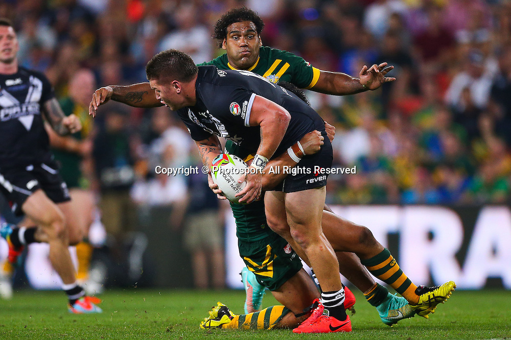 Greg Eastwood is tackled by Dylan Walker and Sam Thaiday during the Four Nations test match between Australia and New Zealand at Suncorp Stadium,  Brisbane Australia on October 25, 2014.