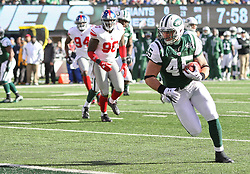 Dec 24, 2011; East Rutherford, NJ, USA; New York Jets tight end Josh Baker (45) catches a 5 yard touchdown pass from New York Jets quarterback Mark Sanchez (6) during the first half of their game against the New York Giants at MetLife Stadium.