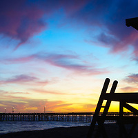 Panorama photo of Lifeguard Tower B and Balboa Pier sunset in Newport Beach California. Newport Beach is a popular coastal beach city along the Pacific Ocean in Orange County Southern California. Panoramic photo ratio is 1:3. Copyright ⓒ 2017 Paul Velgos with All Rights Reserved.