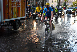 © Licensed to London News Pictures. 24/09/2019. Millbank, London, UK. Commuters navigate puddles in rush hour as heavy rains disrupt parts of Central London. Photo credit: Guilhem Baker/LNP