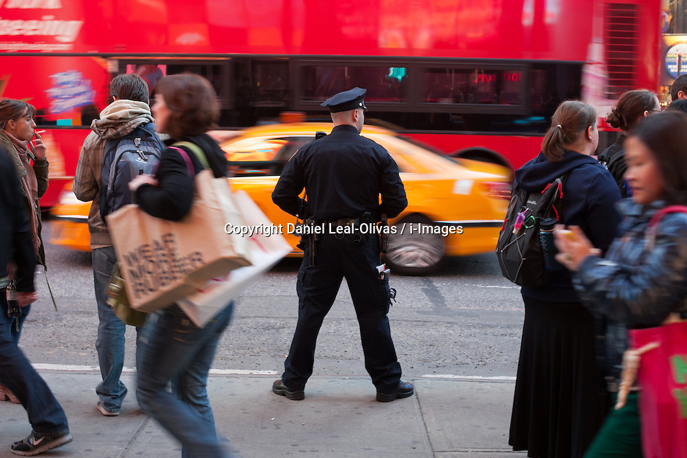 NY police department officer stands on 7th street .In response to the Boston Marathon Bombings, New York City has increased security throughout the city, including a show of presence by the NYPD in Times Square in New York,  ..Two bombs that went off near the finish line of the Boston Marathon killed three people and injured 144, USA, on April 15, 2013, April 18, 2013. Photo by: Daniel Leal-Olivas / i-Images. .