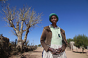Sekururwe is small community in Limpopo. They lost most of their agricultural land in 2005 when it was leased to a platinum mine. These photographs were taken as the community fought to get further compensation from the mine. They believe they were not fully involved in the consultation process or made aware of the affects the mine would bring to the economy of the village, their way of life, their ancestral graves and underground water.<br /> <br /> As a result of negotiations initiated by the Legal Resources Centre the mine made a substantial offer for financial compensation in 2011. South African law stipulates that consent must be gained before mining on communal land yet it is unclear how and whom this consent is gained from.<br /> <br /> Sekuruwe resident Rosina Janker grows what food she can in her garden now that the agriculture land is gone.<br /> <br /> &copy;Zute &amp; Demelza Lightfoot / Legal Resources Centre
