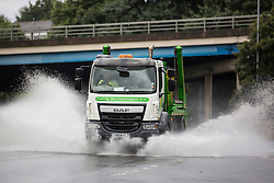 © Licensed to London News Pictures. 10/08/2015. Leeds, UK. Picture shows drivers struggling with standing water on the roads in Leeds after torrential rain fall.<br /> Photo credit : Andrew McCaren/LNP