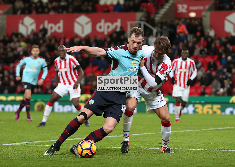 STOKE-ON-TRENT, UNITED KINGDOM 03 DECEMBER 2016: Ashley Barnes of Burnley, holds off Marc Munesia ibn the penalty boxduring the league game between Stoke City and Burnley at the Britannia Stadium, on December 03, 2016 in Stoke-on-Trent, England. (Photo by Michael Poole)