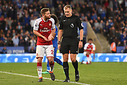 Arsenal defender Shkodran Mustafi (20) pleads with Referee Graham Scott during the Premier League match between Leicester City and Arsenal at the King Power Stadium, Leicester, England on 9 May 2018. Picture by Jon Hobley.