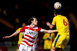 John Marquis of Doncaster Rovers challenges Scott Dann of Crystal Palace - Mandatory by-line: Robbie Stephenson/JMP - 17/02/2019 - FOOTBALL - The Keepmoat Stadium - Doncaster, England - Doncaster Rovers v Crystal Palace - Emirates FA Cup fifth round proper