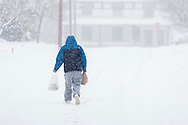 Middletown, New York - A man walks down the street during a snowstorm on Feb. 9, 2017.