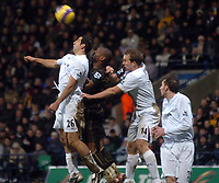 Photo: Paul Greenwood.<br />Bolton Wanderers v Portsmouth. The Barclays Premiership. 30/12/2006. Pompey's Noe Paramott is sandwiched between Tal Ben Haim, left and Kevin Davies