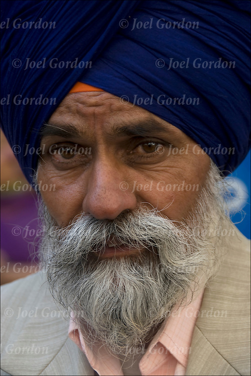 "Portrait of  Sikh-American. Showing his ethnic pride, man with turban usually means he's a Sikh. Religion is called Sikhism, come from the state of Punjab in India, believe in one g-d and do not worship idols, fifth largest monotheistic religion. call g-d ""Wahegura"" meaning ""the supreme teacher"" never cut their hair, believe that men and women are born equal, in monogamy and reincarnation."