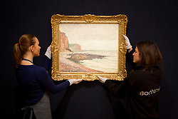 © Licensed to London News Pictures. 31/01/2013. London, UK. Two Bonham's employees adjust a rare coastal painting by Danish-French impressionist painter Camille Pissarro entitled 'Falaises aux Petite-Dalles' (1883) (est. GB£150,000-200,000) at the press view for the Bonhams' Impressionist and Modern Art Sale in London today (31/01/13). The sale, to be held at the London based auction houses New Oxford Street premises on the 5th of February, features a selection of eclectic artists including Camille Pissarro, Fernand Leger and Edgar Degas. Photo credit: Matt Cetti-Roberts/LNP