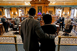 "Jennifer Pinckney, wife of Sen. Clementa Pinckney, and the Rev. Kylon Middleton are greeted by Senate members after they voted 36-3 in favor of removing the Confederate battle flag from State House grounds Tuesday, July 7, 2015 in Columbia. zlaup ""Confederate Flag"""
