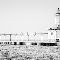 Saint Joseph Lighthouse panoramic black and white picture. The St. Joseph Michigan Lighhouse and pier catwalk are a popular local attraction. The photo is high resolution and was taken in 2013. Panoramic ratio is 1:3.