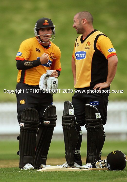 Wellington batsmen BJ Crook and Neal Parlane break for drinks in the morning session.<br /> State Shield cricket. Wellington Firebirds v Otago Volts at Allied Prime Basin Reserve, Wellington. Friday, 2 January 2009. Photo: Dave Lintott/PHOTOSPORT