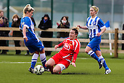 Cardiff's Abbie Britton tackles Brighton's Danielle Rowe during the FA Women's Premier League match between Brighton Ladies and Cardiff City Ladies at Brighton's Training Ground, Lancing, United Kingdom on 22 March 2015. Photo by Geoff Penn.