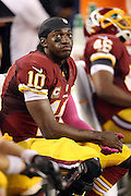 Washington Redskins quarterback Robert Griffin III (10) looks on from the sideline during the NFL week 6 football game against the Dallas Cowboys on Sunday, Oct. 13, 2013 in Arlington, Texas. The Cowboys won the game 31-16. ©Paul Anthony Spinelli
