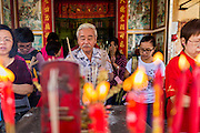 31 JANUARY 2014 - BANGKOK, THAILAND:   Thais gather at a Chinese shrine in Bangkok during Lunar New Year festivities, also know as Tet and Chinese New Year. This year is the Year of the Horse. Ethnic Chinese make up about 14% of Thailand and Chinese holidays are widely celebrated in Thailand.     PHOTO BY JACK KURTZ