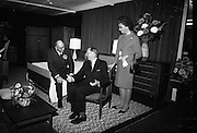 Irish Furniture Fair..1966..27.09.1966..09.27.1966..27th September 1966..Today saw the opening of the Irish Furniture Fair at the Intercontinental Hotel in Dublin. The fair is to promote the quality and value of furniture manufactured within Ireland...Image shows the Minister for Industry and Commerce, Mr George Colley TD,trying out one of the chairs on display at the fair.