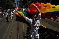 SAN FRANCISCO, CA - JUNE 24 : People carry a rainbow balloon flag as they take part in the 37th annual LBGT Pride Parade on June 24, 2007 in San Francisco, California. Hundreds of thousands of people lined the streets of San Francisco to watch and take part in the parade.  (Photograph by David Paul Morris)