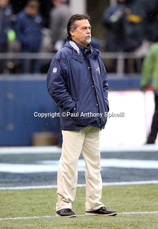 St. Louis Rams head coach Jeff Fisher looks on during pregame warmups before the 2015 NFL week 16 regular season football game against the Seattle Seahawks on Sunday, Dec. 27, 2015 in Seattle. The Rams won the game 23-17. (©Paul Anthony Spinelli)