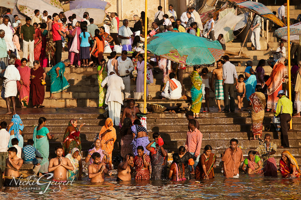 Crowd of people ritual bathing, Ganges river, Varanasi, India. Fine art photography prints. People and place wall art for sale.