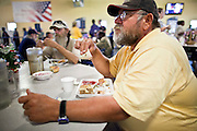 "Sept. 27 - PHOENIX, AZ: DeLANO, a client at the Society of St. Vincent de Paul in Phoenix, eats his lunch, Monday, Sept 27. He's coming to lunch service at St. Vincent de Paul for about a month. September 27, 2010 is the 350th Feast Day of Saint Vincent de Paul, also known as the ""Apostle of Charity."" To mark the day, the Society of St. Vincent de Paul in Phoenix served birthday cake during the lunch service. The US Census office recently announced that poverty in the US has spiked to 14.3% of the population, the highest poverty rate since 1994. Officials at St. Vincent de Paul in Phoenix said that demand for their services have increased steadily in the last three years. They currently feed about 1,100 people, either homeless or members of the working poor, every day.    Photo by Jack Kurtz"