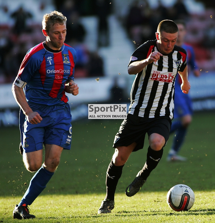The Clydesdale Bank Scottish Premier League, Season 2011/12.Dunfermline Athletic Football Club v Inverness CT Football Club .18-02-12...Joe Cardle outruns Richie Foran in this evenings  Clydesdale Bank Scottish Premier League game between Dunfermline Athletic FC and Inverness CT FC..At East End Park Stadium, Dunfermline...Picture, Craig Brown ..Saturday 18th February 2012.