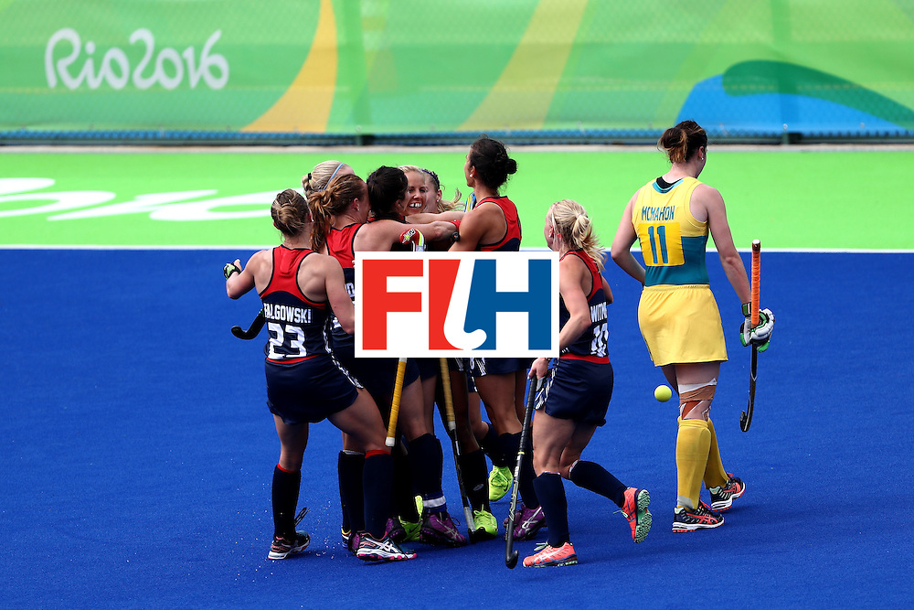 RIO DE JANEIRO, BRAZIL - AUGUST 08:  Lauren Crandall #27, Katelyn Falgowski #23, Jill Witmer #10 and Kelsey Kolojejchick #7 of United States celebrate a goal as Karri Mcmahon #11 of Australia walks away during a Women's Pool B match  on Day 3 of the Rio 2016 Olympic Games at the Olympic Hockey Centre on August 8, 2016 in Rio de Janeiro, Brazil.  (Photo by Sean Haffey/Getty Images)
