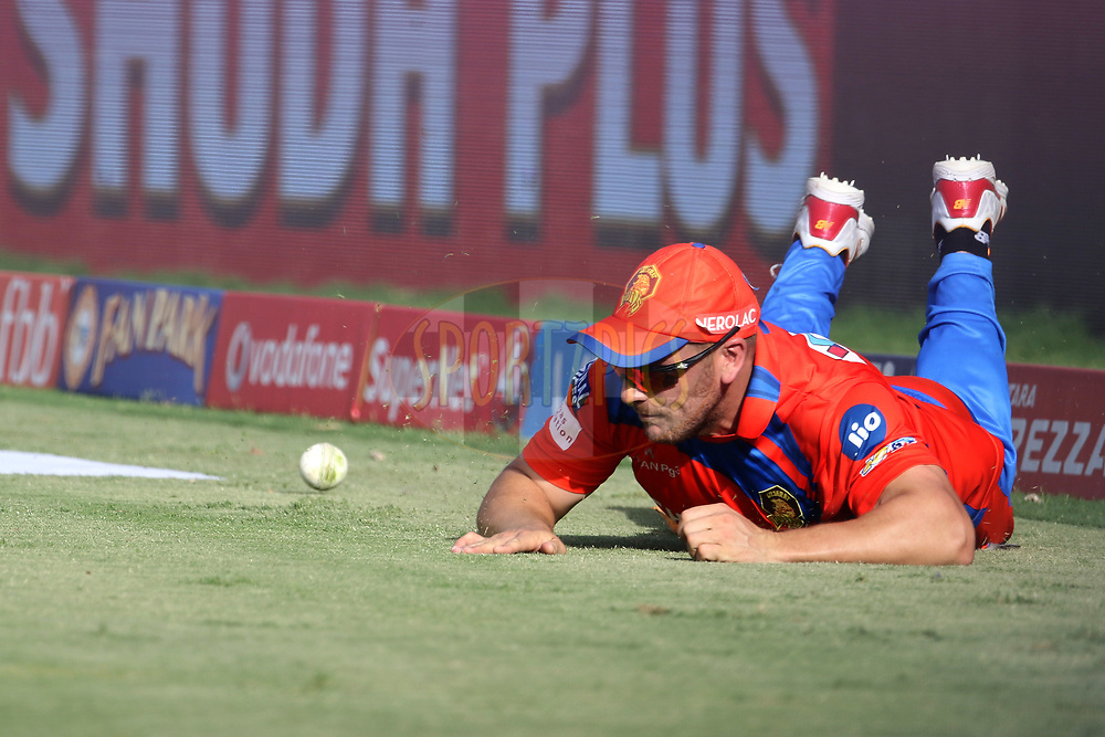 Aaron Finch of the Gujarat Lions stops a boundary during match 26 of the Vivo 2017 Indian Premier League between the Gujarat Lions and the Kings XI Punjab held at the Saurashtra Cricket Association Stadium in Rajkot, India on the 23rd April 2017<br /> <br /> Photo by Vipin Pawar - Sportzpics - IPL