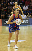 Temepara George looks down court to pass during round 4 of the ANZ Netball Championship - Queensland Firebirds v Northern Mystics. Played at Brisbane Convention Centre. Firebirds (46) defeated the Mystics (40).  Photo: Warren Keir (SMP/Photosport).<br /> <br /> Use information: This image is intended for Editorial use only (e.g. news or commentary, print or electronic). Any commercial or promotional use requires additional clearance.