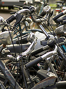 close up of the bicycles steering parked in a rack