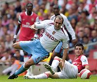 Photo: Daniel Hambury.<br />Arsenal v Aston Villa. The Barclays Premiership. 19/08/2006.<br />Arsenal's Francesc Fabregas tackles Villa's Gavin McCann.