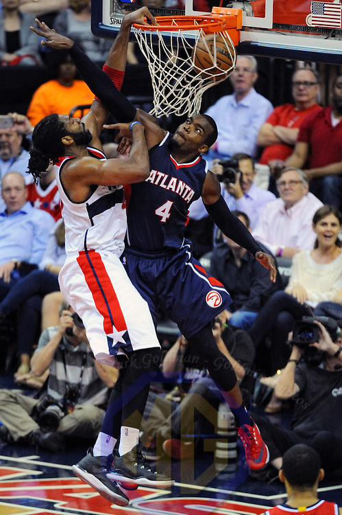 11 May 2015:  Washington Wizards forward Nene Hilario (42) dunks the ball against Atlanta Hawks forward Paul Millsap (4) in Game 4 of Round 2 of the Eastern Conference Semifinals at the Verizon Center in Washington, D.C. The Atlanta Hawks defeated the Washington Wizards, 106-101.(Photograph by Mark Goldman/Goldminephotos)