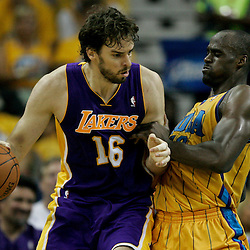 April 22, 2011; New Orleans, LA, USA; Los Angeles Lakers power forward Pau Gasol (16) is guarded by New Orleans Hornets center Emeka Okafor (50) during the first half in game three of the first round of the 2011 NBA playoffs at the New Orleans Arena. The Lakers defeated the Hornets 100-86.   Mandatory Credit: Derick E. Hingle