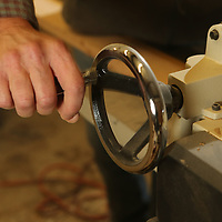 Keith adjusts his planer to the boards he uses perfectly flat.