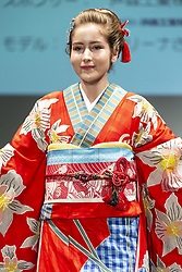 May 2, 2019 - Tokyo, Japan - A model dressed up a Japanese kimono inspired in the Republic of Singapore walks on the runway during the Imagine One World Kimono Project event in Tokyo. The Imagine One World Kimono Project aims to create 213 kimonos to represent each of the nations that will take part in the next 2020 Tokyo Olympic and Paralympic Games. (Credit Image: © Rodrigo Reyes Marin/ZUMA Wire)