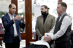 The Duke of Cambridge speaks to Tom Chapman founder of the charity and barber Daniel Davies (right) as he meets members of the Lion Barbers Collective, who are raising awareness of suicide prevention through a programme called BarbersTalk, during a visit to Pall Mall Barbers in Paddington, west London.