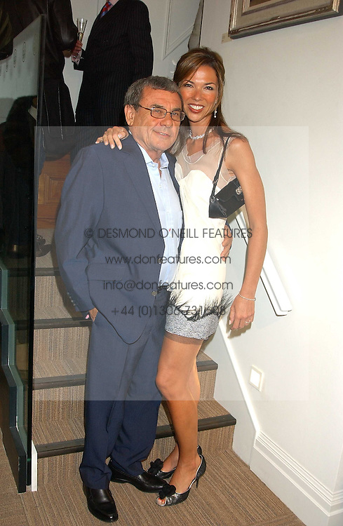SOL & HEATHER KERZNER at a party hosted by the Gussalli Beretta family to celebrate the opening of the new Beretta store, 36 St.James's Street, London SW1 on 10th January 2006.<br />