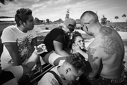 July 2, 2017 - Latin Kings gather at a park during an important monthly meeting called Reunion del Sol (Meeting of the Sun), during the meeting the discuss new charges and missions they have to accomplish during the month, once the meeting is over they share food and drinks. (Credit Image: © Nicolas Enriquez via ZUMA Wire)