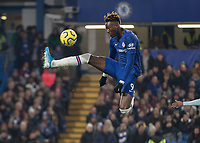 Football - 2019 / 2020 Premier League - Chelsea vs. Aston Villa<br /> <br /> Tammy Abraham (Chelsea FC) brings the high ball under control at Stamford Bridge <br /> <br /> COLORSPORT/DANIEL BEARHAM