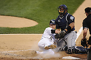 CHICAGO - JUNE 07:  Gordon Beckham #15 of the Chicago White Sox is tagged out at home plate by Miguel Olivo #30 of the Seattle Mariners in the third inning on June 7, 2011 at U.S. Cellular Field in Chicago, Illinois.  The White Sox defeated the Mariners 5-1.  (Photo by Ron Vesely)  Subject:  Gordon Beckham;Miguel Olivo..