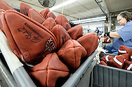 Official game balls for the NFL football Super Bowl XLIX wait to be laced at the Wilson Sporting Goods Co. in Ada, Ohio, Tuesday, Jan. 20, 2015. The New England Patriots will play the Seattle Seahawks in the Super Bowl on Feb. 1 in Glendale, Arizona. (AP Photo/Rick Osentoski)