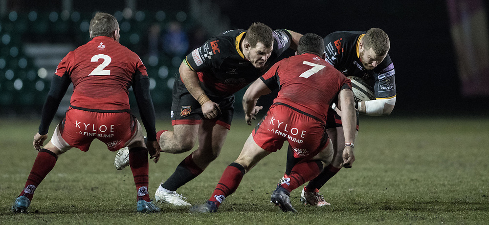 Dragons' Sam Hobbs links with Lloyd Fairbrother as he charges with ball in hand at Edinburgh' John Hardie.<br /> <br /> Photographer Simon Latham/Replay Images<br /> <br /> Guinness PRO14 - Dragons v Edinburgh - Friday 23rd February 2018 - Eugene Cross Park - Ebbw Vale<br /> <br /> World Copyright © Replay Images . All rights reserved. info@replayimages.co.uk - http://replayimages.co.uk