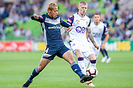 Melbourne Victory midfielder Keisuke Honda (4) attacks the ball at the Hyundai A-League Round 2 soccer match between Melbourne Victory and Perth Glory at AAMI Park in Melbourne.