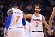 Mar 9, 2016; Phoenix, AZ, USA; New York Knicks guard Jose Calderon (3) smiles while high fiving teammate forward Carmelo Anthony (7) in the first half at Talking Stick Resort Arena. Mandatory Credit: Jennifer Stewart-USA TODAY Sports
