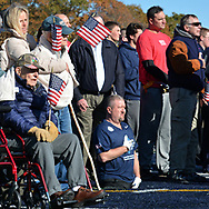 (Westwood, Ma 111117) People face the American flag during the singing of the national anthem before a flag football game between the Wounded Warrior Amputee Football Team and New England Patriots and NFL alumni at Xaverian Brothers High School. November 11, 2017 Staff photo by Chris Christo