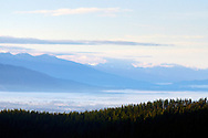 Overlooking the Flathead Valley and the Swan Mountain Range at dawn from Haskill Basin, F,H, Stoltze Land & Lumber Co. property. From assignment work for The Trust for Public Land. Flathead County, Montana.